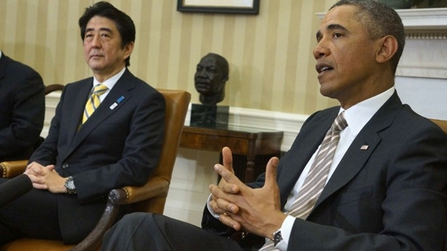 Feb. 22, 2013: President Barack Obama meets with Japan's Prime Minister Shinzo Abe in the Oval Office of the White House in Washington.