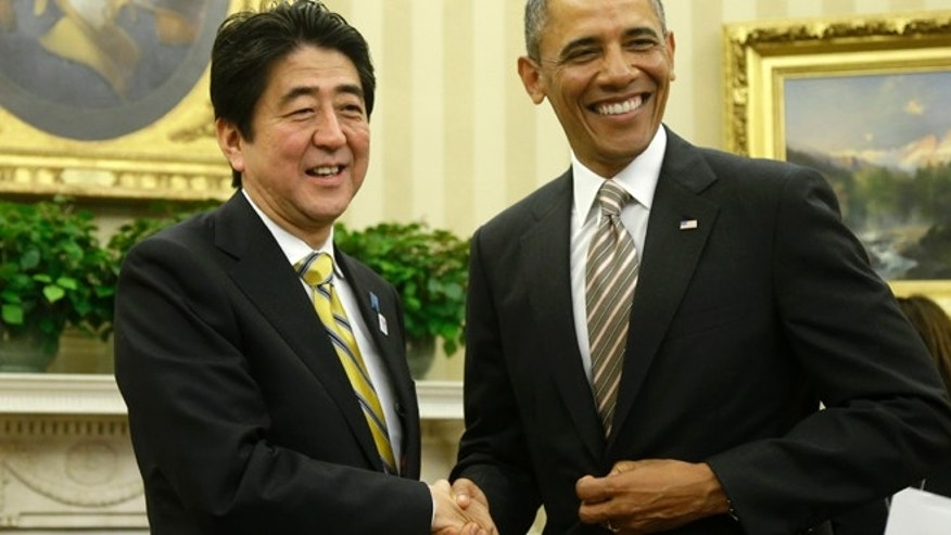 Feb. 22, 2013: President Barack Obama shakes hands with Japan's Prime Minister Shinzo Abe in the Oval Office of the White House in Washington.