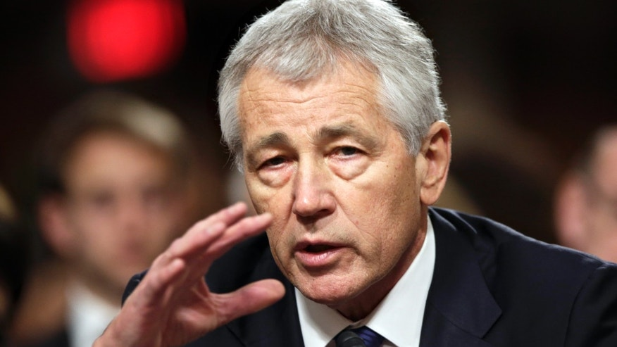 FILE - In this Jan. 31, 2013 file photo, former Nebraska Republican Sen. Chuck Hagel, President Obama's choice for defense secretary, testifies before the Senate Armed Services Committee during his confirmation hearing, on Capitol Hill in Washington. A bitterly divided Senate panel on Tuesday, Feb. 12, 2013, voted to approve Hagel to be the nation's defense secretary at a time of turmoil for the military with looming budget cuts, a fresh sign of North Korea's nuclear ambitions and drawdown of U.S. forces in Afghanistan. (AP Photo/J. Scott Applewhite, File)