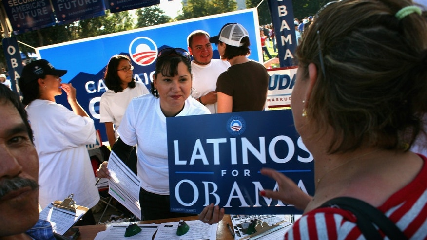 DENVER - SEPTEMBER 14:  Democratic Party workers hand out signs at a celebration marking Mexican Independence Day September 14, 2008 in Denver, Colorado. The Democratic Party is working hard to register Latino voters in Colorado, which will be an important swing state in November's presidential election. (Photo by John Moore/Getty Images)