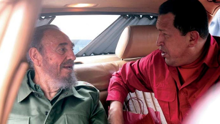 "In this July 22, 2006 photo released by Miraflores Press Office, Venezuela's President Hugo Chavez , right, speak with Cuba's Fidel Castro during their visit to the home of Cuban revolutionary Ernesto ""Che"" Guevara in Cordoba, Argentina. Venezuela's Vice President Nicolas Maduro announced on Tuesday, March 5, 2013 that Chavez has died.  Chavez, 58, was first diagnosed with cancer in June 2011. (AP Photo/Miraflores Press Office)"