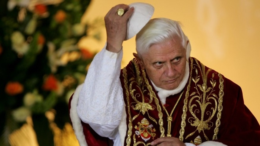 May 25, 2006: Pope Benedict XVI lifting his scull cap during an ecumenical meeting at the Holy Trinity church in Warsaw, Poland. (AP)