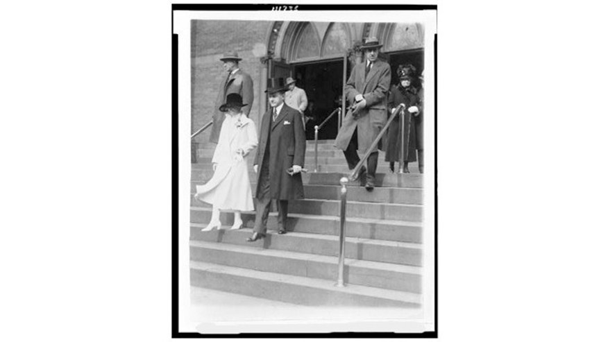 President Calvin Coolidge and his wife leaving church.