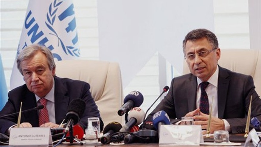 March 11, 2013: United Nations High Commissioner for Refugees, UNHCR, chief Antonio Guterres, left, and Turkish Prime Ministry Disaster and Emergency Managment President Fuat Oktay speak to media after they signed a cooperation agreement in Ankara, Turkey. Guterres has visited Syrian refugee camps along the border between Turkey and Syria on Sunday.