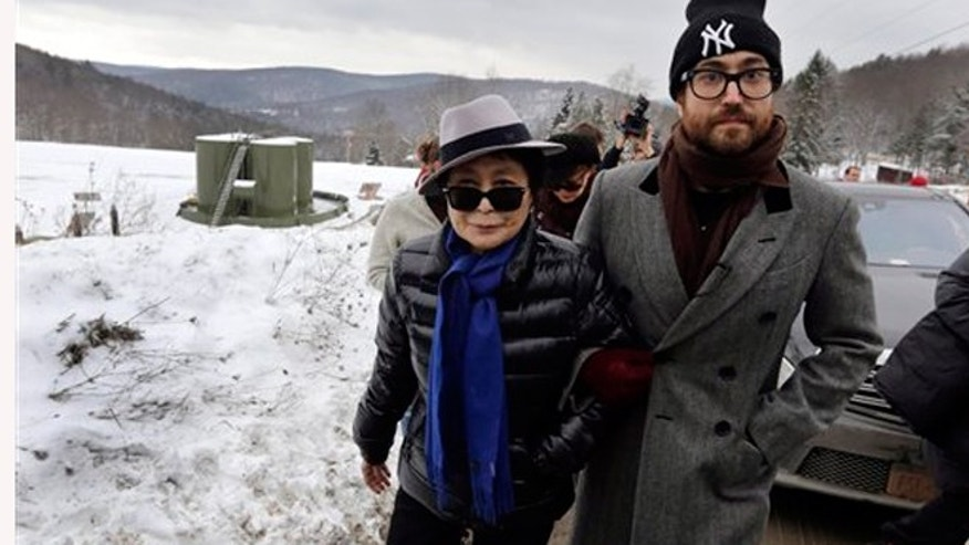 "FILE - Jan. 17, 2013: Yoko Ono, left, and her son Sean Lennon visit a fracking site in Franklin Forks, Pa., during a bus tour of natural-gas drilling sites in northeastern Pennsylvania. Ono and Lennon have formed a group called ""Artists Against Fracking,"" which has become the main celebrity driven anti-fracking organization."