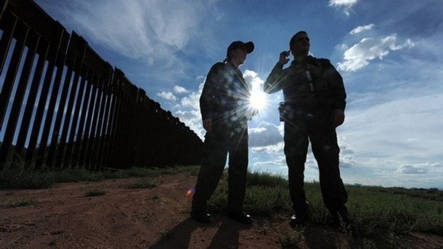 July 28: US Border Patrol agents patrol along the border fence between Arizona and Mexico at the town of Nogales. A federal judge blocked the most controversial parts of Arizona's new immigration law Wednesday, barring police from checking the immigrant status of suspected criminals. The ruling came hours before the new law had been due to go into effect, handing temporary victory to civil rights groups and the Obama administration which has challenged the legislation. (Getty Images)
