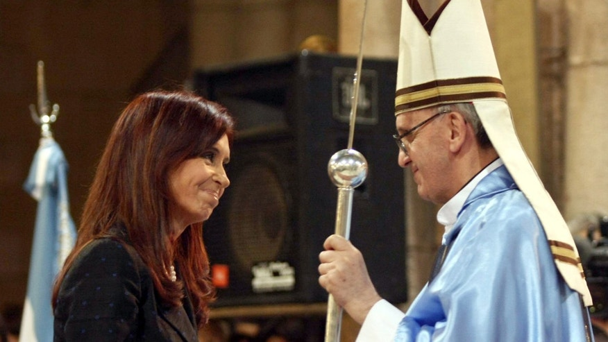FILE - In this Dec. 12, 2008 file photo, Argentina's President Cristina Fernandez, left, shakes hands with Buenos Aires' archbishop Jorge Mario Bergoglio in Lujan, Argentina.