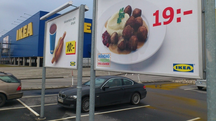 FILE -- Feb. 25, 2012: Advertising for Ikea meat balls at the parking area at an Ikea store in Malmo, Sweden. Furniture retailer Ikea says it has halted all sales of meat balls in Sweden after Czech authorities detected horse meat in frozen meatballs that were labeled as beef and pork.