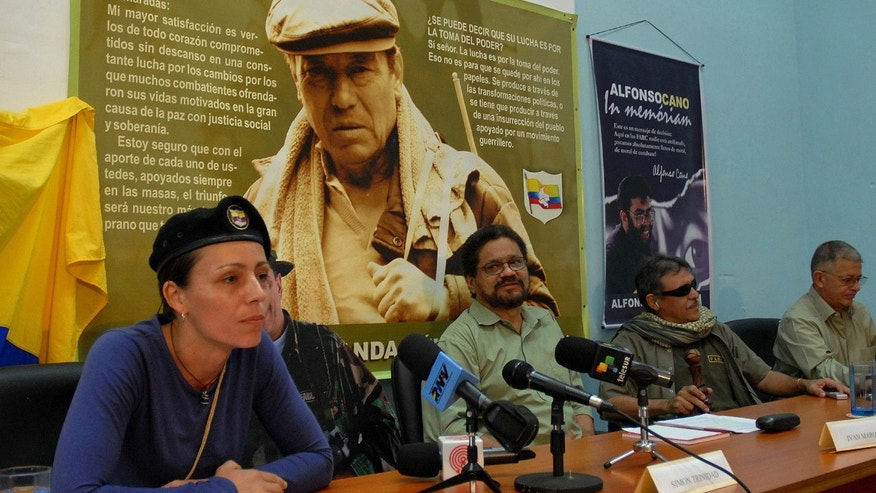 Dutch rebel Tanja Nijmeijer from FARC speaks with fellow member of the negotiating team Iván Márquez, center right, and Jesus Santrich,second from right, in Havana, Cuba.