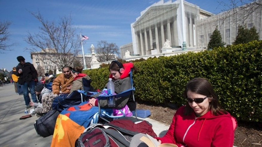 March 23, 2013: Those hoping to get a seat for the upcoming U.S. Supreme Court arguments on gay marriage line up early outside the court in Washington.
