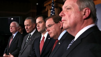 WASHINGTON, DC - JANUARY 28:  (L-R) U.S. Sen. John McCain (R-AZ), Sen. Charles Schumer (D-NY), Sen. Marco Rubio (R-FL), Sen. Robert Menendez (D-NJ), and Senate Majority Whip Sen. Richard Durbin (D-IL) listen during a news conference on a comprehensive immigration reform framework January 28, 2013 on Capitol Hill in Washington, DC. A group of bipartisan senate members have reached to a deal of outlines to reform the national immigration laws that will provide a pathway for the 11 million illegal immigrants in the country to citizenship.  (Photo by Alex Wong/Getty Images)