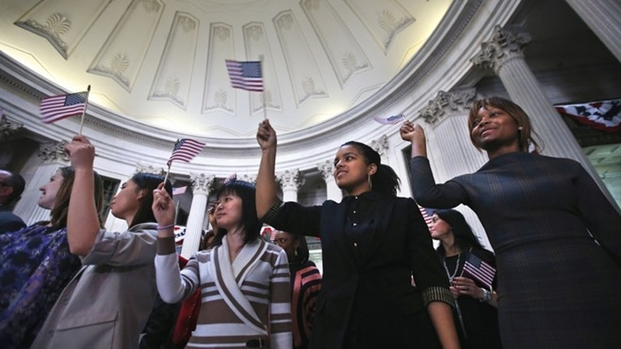 Immigrants celebrate after becoming American citizens at a naturalization ceremony at Federal Hall on March 22, 2013 in New York City.