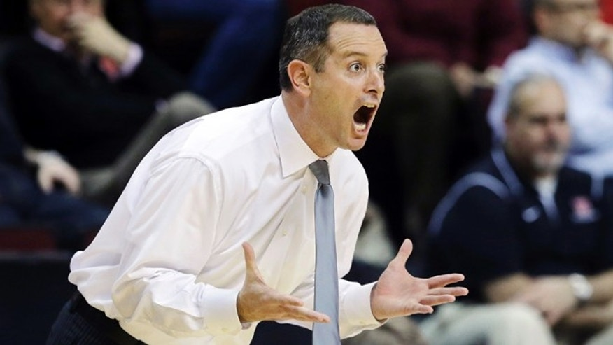 Jan. 17, 2013: In this file photo, Rutgers head coach Mike Rice reacts to a play during the first half of an NCAA college basketball game against South Florida in Piscataway, N.J.
