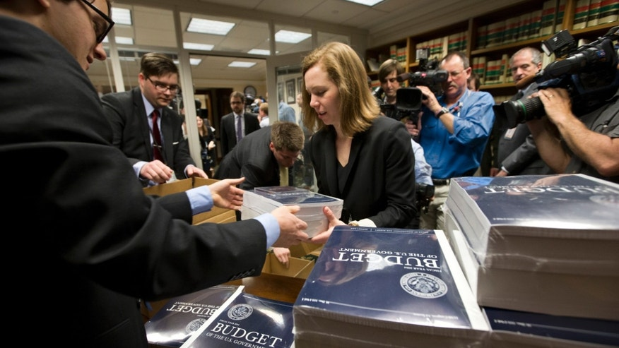 Copies of President Barack Obama's budget plan for fiscal year 2014 are distributed to Senate staff in Capitol Hill.