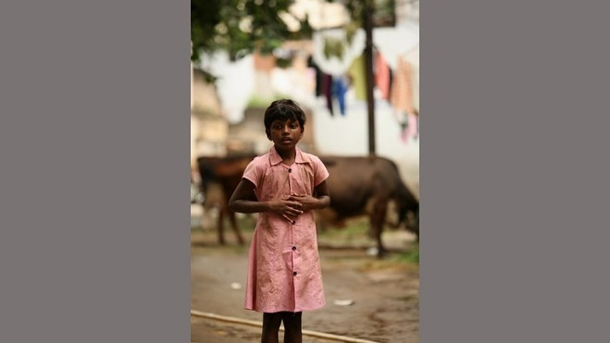 "Mumbai, India: In the film ""Not Today"" young Annika, played by Persis Karen, searches for her father in cow alley."