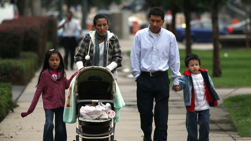 DENVER, CO - JULY 13:  Undocumented Mexican immigrant Jeanette Vizguerra (L), her husband Salvador and their children Luna, 7, and Roberto, 5, walk to her immigration hearing in federal court on July 13, 2011 in Denver, Colorado. At the hearing, the court said it would not release it's verdict on her possible deportation until October, leaving her and her family in continued uncertainty. Vizguerra is a mother of four children, three of whom were born in the U.S. as American citizens. If Vizguerra is deported back to Mexico, she says her husband and children will stay on in the United States. Just one of millions of undocumented immigrants living in the U.S., Vizguerra first came to Colorado from Mexico City with her husband and first child 14 years before. Now an activist for the immigration advocate group Rights For All People, she also owns a janitorial service and says she has always paid state and federal taxes on her income. Some two years ago she was stopped by a traffic policemen for driving with expired tags and taken to jail when she could not prove her legal immigration status. Out on bail during court proceedings, she now faces the real possibility that she will be deported to Mexico and separated from her family in the United States.  (Photo by John Moore/Getty Images)