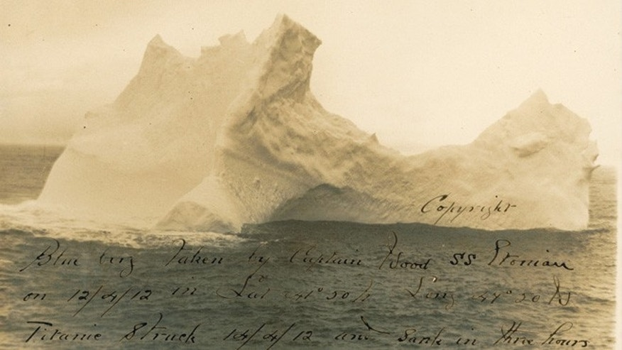 Nov. 28, 2012: Is this a photograph of the iceberg that did the unthinkable: sinking the RMS Titanic? On April 12, 1912, Captain W. F. Wood aboard the steamer S. S. Etonian photographed a massive iceberg with a distinctive elliptical shape. Wood found the picture remarkable enough to print it out and annotate it with the current latitude and longitude. Two days later, on April 14, the unsinkable Titanic struck an iceberg and sank to bottom of the Atlantic Ocean. That iceberg had the same elliptical shape, according to sketches made on the ship. Wood had captured the remarkable piece of ice, said Craig Sophin, a Titanic expert and consultant to the auctioneers.