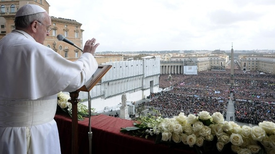 March 31, 2013: In this photo provided by the Vatican newspaper L'Osservatore Romano, Pope Francis delivers the Urbi et Orbi (to the city and to the world) blessing, in St. Peter's Square at the Vatican.