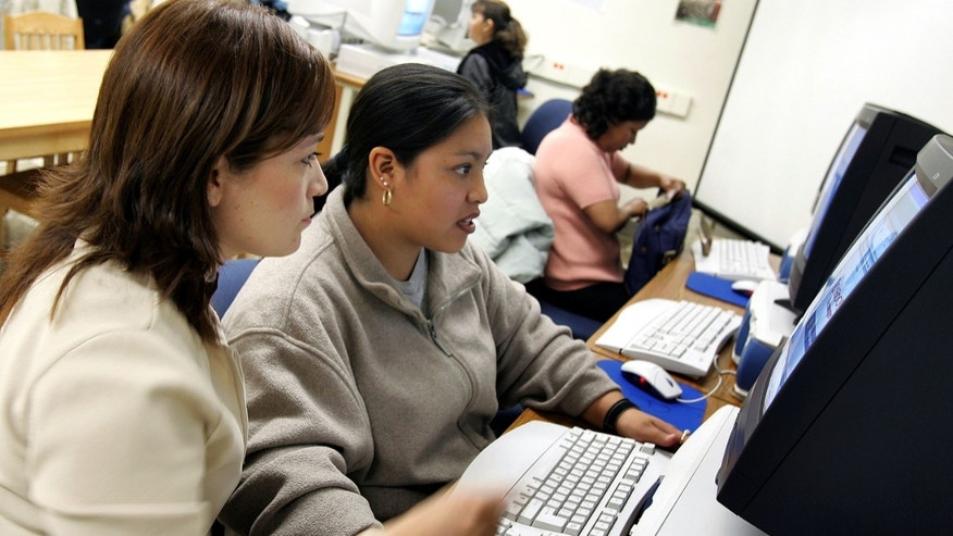 CHICAGO - MAY 02: Class instructor Ana Arredondo (L) assists student Rosa Galan at the Community Learning Resource Center May 2, 2005 at Perez Elementary School in the largely Hispanic Pilsen neighborhood in Chicago, Illinois. Spanish-speaking parents of Chicago Public School (CPS) students will have the opportunity to learn basic computer skills at no cost through a partnership between the CPS Office of Language and Cultural Education and the Mexican university Tecnologico de Monterrey, in Monterrey, Mexico. Upon completion of the 16-week program, parents will receive a diploma from the Tecnologico de Monterrey. (Photo by Tim Boyle/Getty Images)