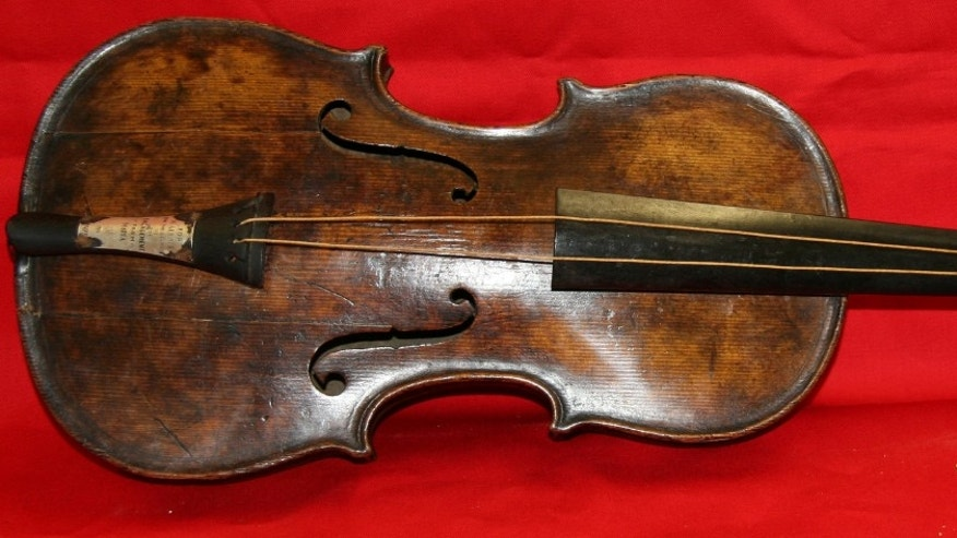In this undated photo provided by Henry Aldridge shows the violin that was played by the bandmaster of the Titanic as the oceanliner sank, Devizes, England.