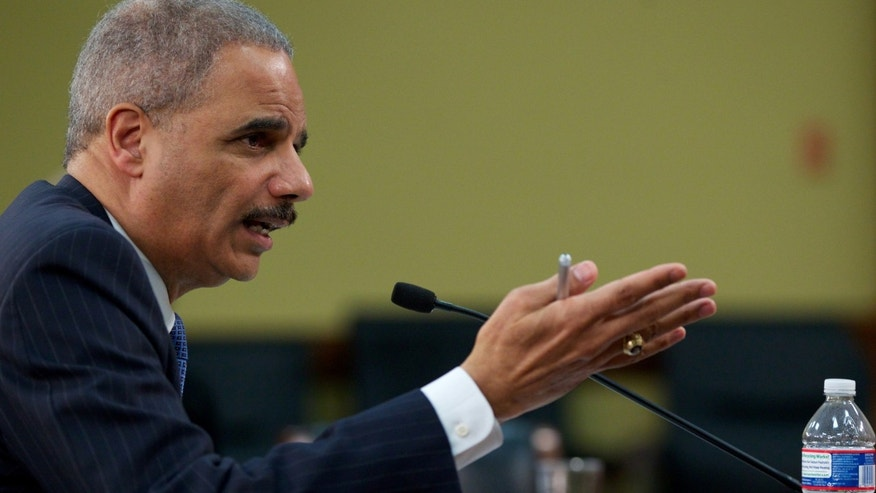 In this April 18, 2013 file photo, Attorney General Eric Holder testifies on Capitol Hill in Washington.