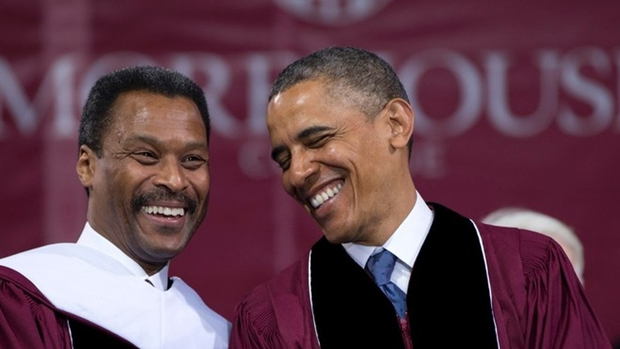 President Obama and Morehouse President John Silvanus Wilson Jr., together on stage during the Morehouse College 129th Commencement ceremony, Sunday, May 19, 2013, in Atlanta.