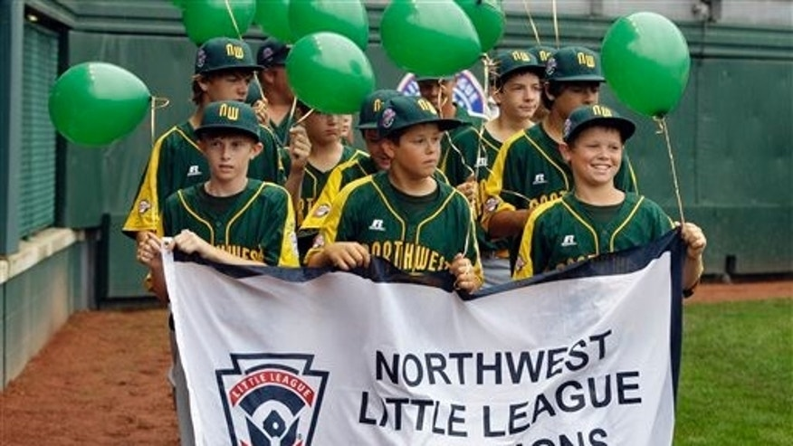 Members of the Mercer Island, Wash., team enter Volunteer Stadium during the opening ceremony of the Little League World Series, Friday, Aug. 21, 2009, in South Williamsport, Pa. (AP Photo/Carolyn Kaster)