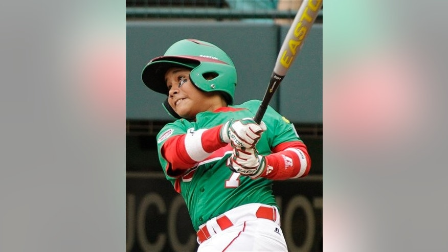 Mexicali,, Mexico's Bruno Ruiz hits a solo home run off Maracay, Venezuela, pitcher Yonny Hernandez in the ninth inning of a baseball game at the Little League World Series in South Williamsport, Pa., Wednesday, Aug. 24, 2011. Mexico won 2-1 in nine innings. (AP Photo/Gene J. Puskar)