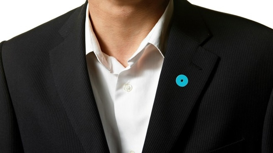 Shown here: the No More lapel pin.