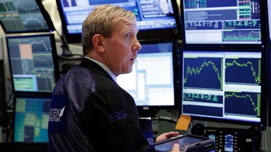 June 17, 2013: Trader Richard Cohen works in a booth on the floor of the New York Stock Exchange.