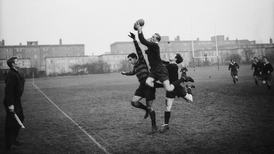 American Rhodes student and Oxford rugby blue Peter Dawkins catches the ball during a match against Blackheath, 14th November 1959.