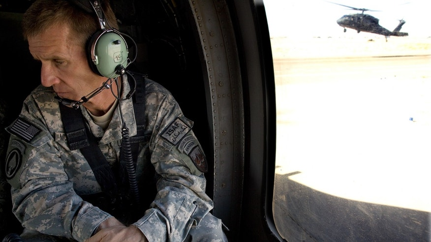 Commander General Stanley A. McChrystal sits in a helicopter outside of Kandahar, Afghanistan, October 7, 2009.