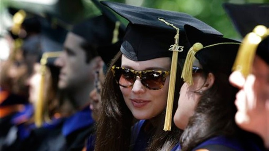 FILE -- June 4, 2013: Students talk during Princeton University's graduation ceremonies in Princeton, N.J. Princeton awarded degrees to 2,158 undergraduate and graduate students.