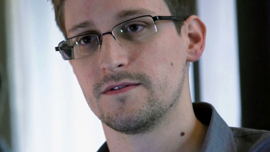 FILE -- This photo provided by The Guardian Newspaper in London shows Edward Snowden, who worked as a contract employee at the National Security Agency, in Hong Kong on June 9, 2013.