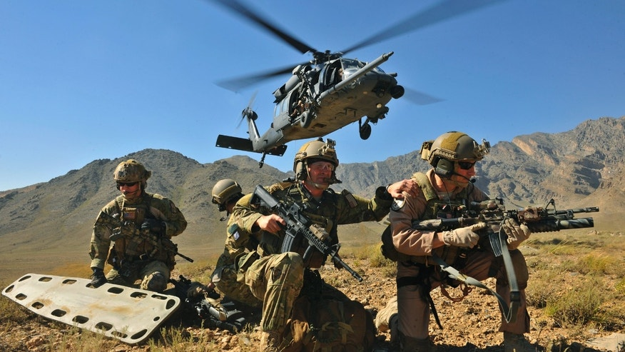 BAGRAM AIRFIELD, AFGHANISTAN - SEPTEMBER 24:  (EDITORS NOTE: Image has been reviewed by U.S. Military prior to transmission.) In this handout provided by the U.S. Air Force, a HH-60G Pave Hawk hovers over pararescuemen and Brig. Gen. Jack L. Briggs, the 455th Air Expeditionary Wing commander, during a training mission at Bagram Airfield, Afghanistan, Sept. 24, 2010. The training mission provided a glimpse of what the 33rd Expeditionary Rescue Squadron brings to the fight and the capabilities it provides to combat commanders. (Photo by Christopher Boitz/US Air Force via Getty Images)