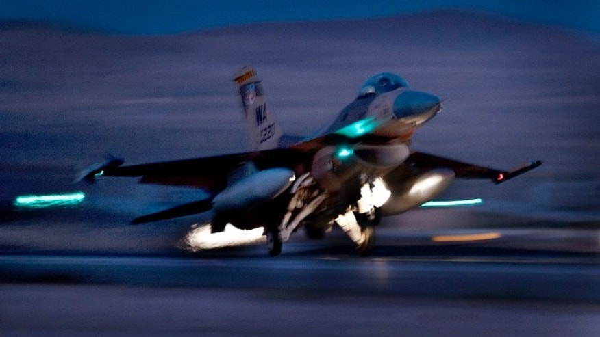 Oct. 30, 2012: An F-16 Fighting Falcon aircraft takes off for a night mission at Nellis Air Force Base, Nev. Air Force F-16 fighters, Civil Air Patrol aircraft and a U.S. Coast Guard MH-65 Dolphin helicopter will all participate in night exercises over Washington, D.C., in early December.