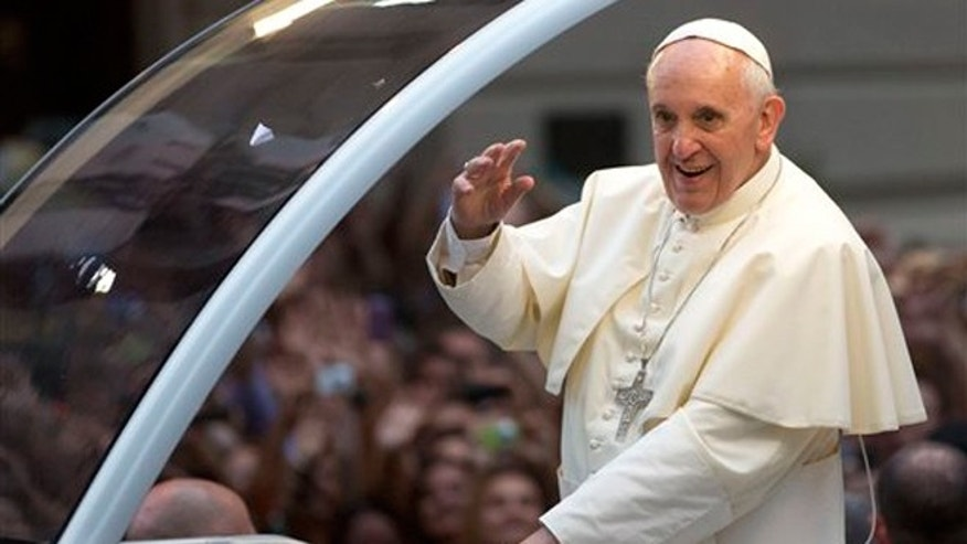 FILE -- July 22, 2013: Pope Francis waves to crowds in Rio de Janeiro, Brazil.