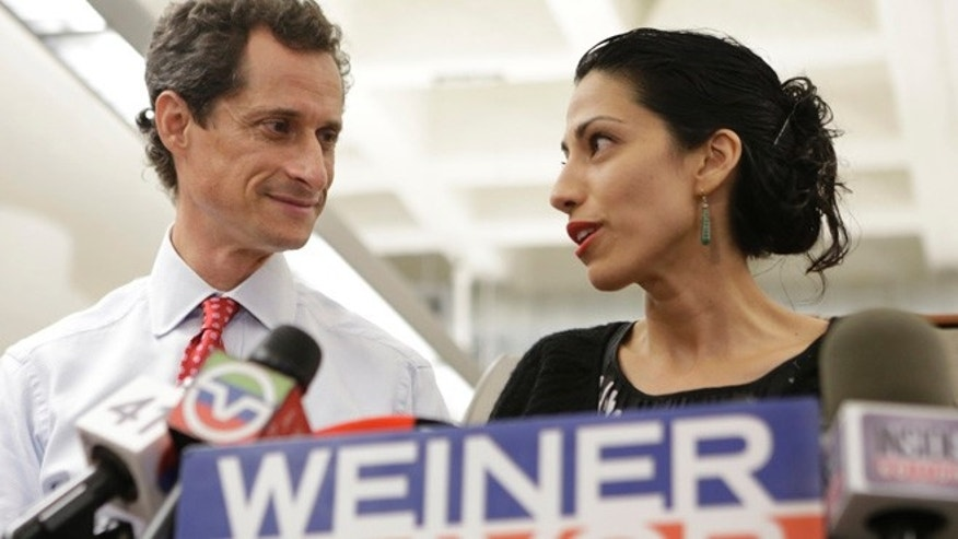 July 23, 2013: Huma Abedin, alongside her husband, New York mayoral candidate Anthony Weiner, speaks during a news conference at the Gay Men's Health Crisis headquarters in New York.