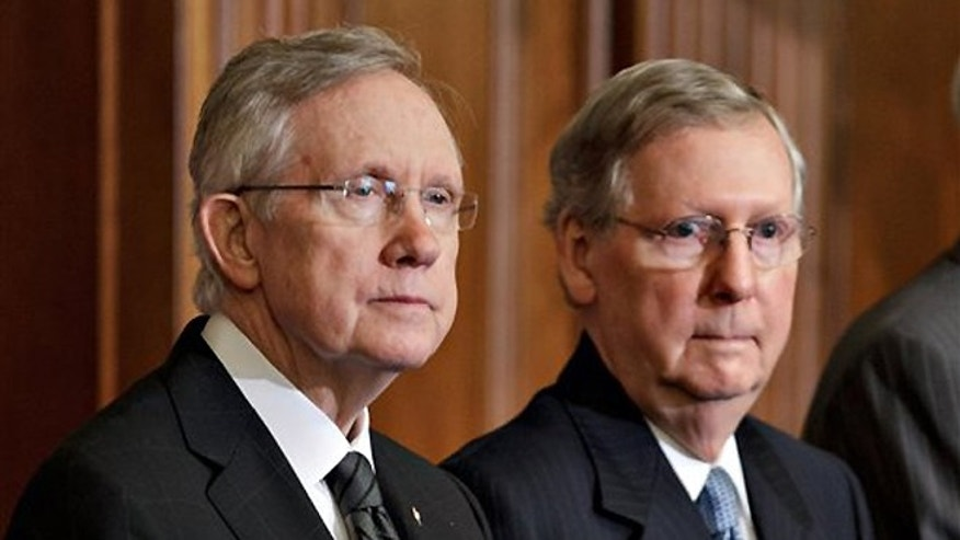 FILE -- July 11, 2012: Senate Majority Leader, Democrat Harry Reid of Nevada, and Senate Minority Leader, Republican Mitch McConnell of Kentucky, right, participate in an award ceremony at the U.S. Capitol in Washington.