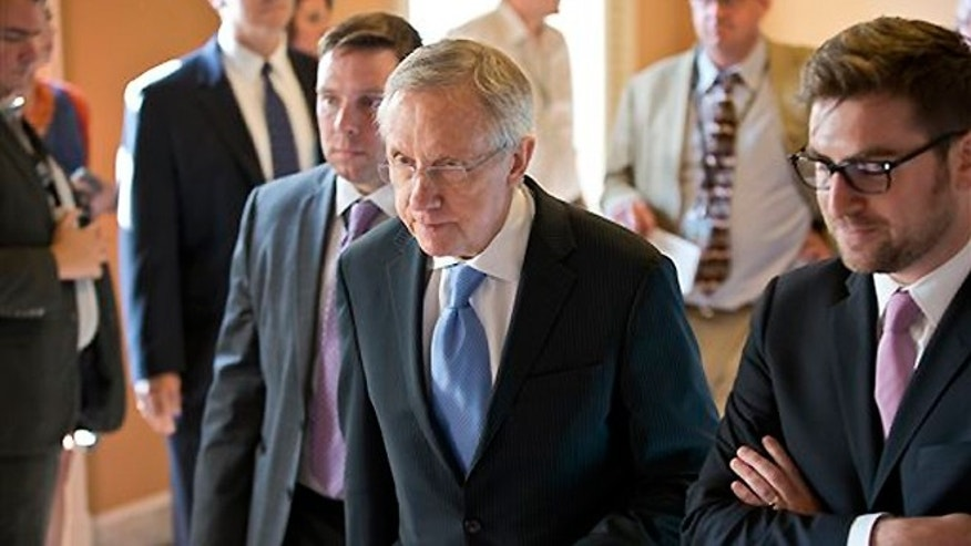 FILE -- July 15, 2013: Senate Majority Leader Harry Reid (D-Nev.), center, walks to closed-door meeting in the Old Senate Chamber for a showdown over presidential nominees that have been blocked by a GOP filibuster, at the Capitol in Washington.