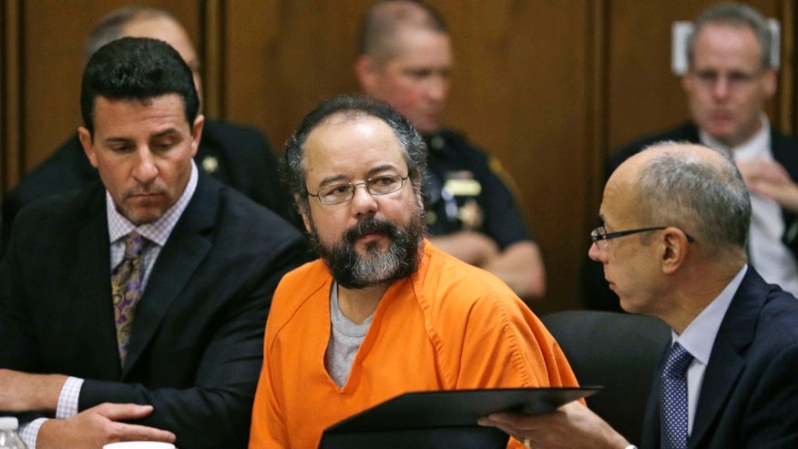 Aug. 1, 2013: Ariel Castro, center, listens in the courtroom during the sentencing phase of his trial, in Cleveland. Defense attorney's Craig Weintraub, left, and Jaye Schlachet sit beside Castro.