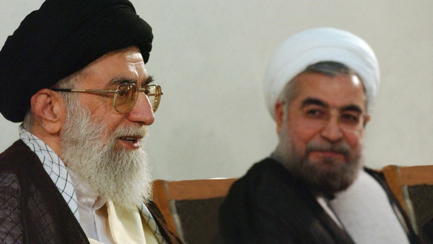 June 16, 2013 - Photo released by the official website of the Iranian supreme leader's office, supreme leader Ayatollah Ali Khamenei, left, speaks during his meeting with President-elect Hasan Rowhani in Tehran, Iran.