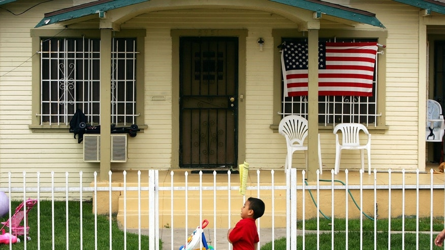 MAYWOOD, CA - MAY 17:  An American flag hangs on a single-family home in this Latino neighborhood May 17, 2006 in the Los Angeles-area city of Maywood, California. In November, voters, angered that city police were stopping and seizing hundreds of cars whose unlicensed drivers frequently turned out to be illegal immigrants, elected a new majority on the city council. The new council majority promptly voted to eliminate the police department's traffic division, resulting in car impoundments dropping from 240 a month to 40. The city in January also officially opposed a proposed federal law that would have criminalized illegal immigration and forced local police to enforce immigration law. Approximately 96 percent of the city's 29,000 residents is Latino, with an additional 10,000 illegal residents living within city limits, according to estimates.  (Photo by David McNew/Getty Images)