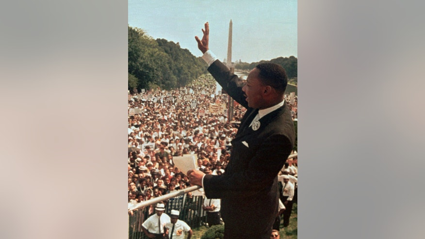 "FILE -  Dr. Martin Luther King Jr. acknowledges the crowd at the Lincoln Memorial for his ""I Have a Dream"" speech during the March on Washington, D.C. in this Aug. 28, 1963 file photo. Former South African President Nelson Mandela never met with King but the two fought for the same issues at the same time on two different continents. Mandela said in a 1964 speech that he was prepared to die to see his dream of a society where blacks and whites were equal become reality. King was killed by an assassin's bullet while working for that same dream. (AP Photo/File)"