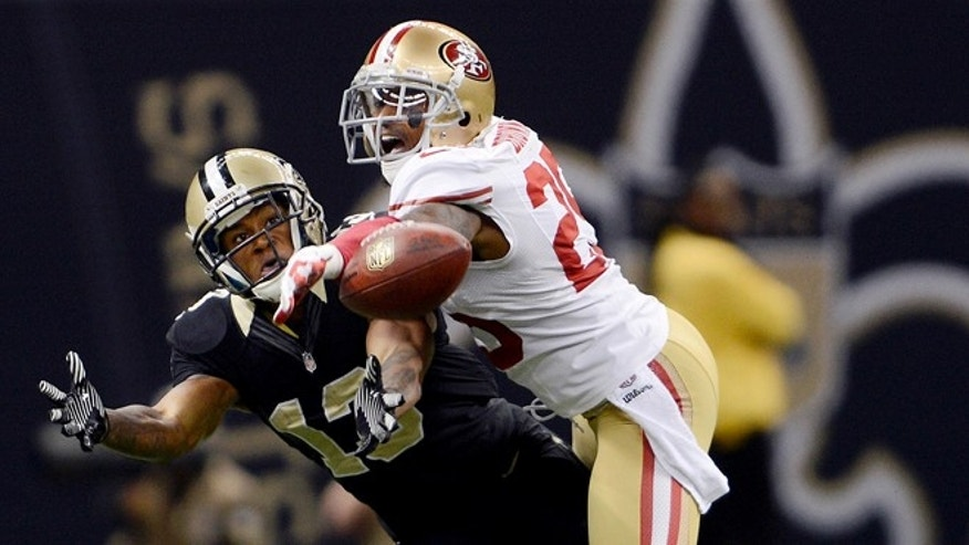 Nov. 25, 2012: San Francisco 49ers cornerback Tarell Brown (25) breaks up a pass intended for New Orleans Saints wide receiver Joe Morgan (13) in the second half of an NFL football game.