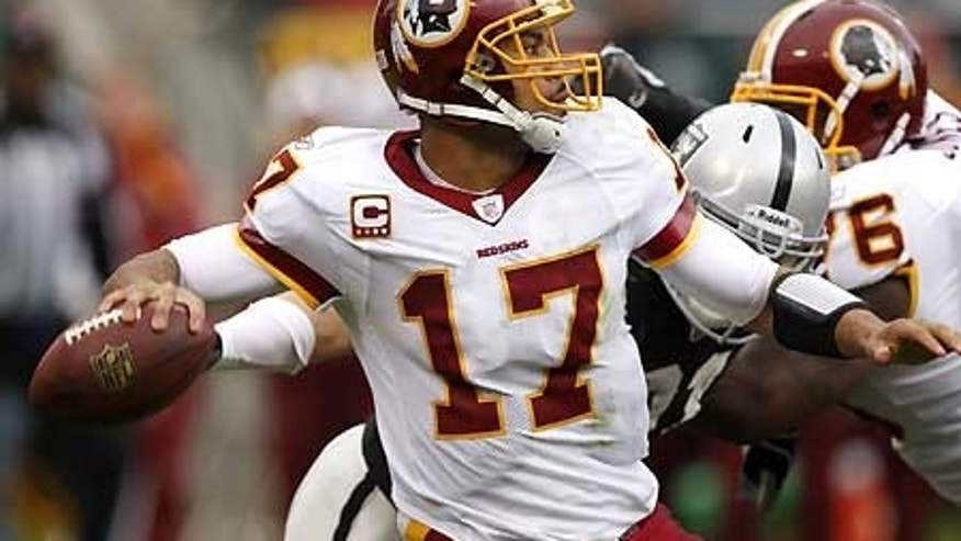 Dec. 13: Washington Redskins quarterback Jason Campbell (17) drops back to pass against the Oakland Raiders.