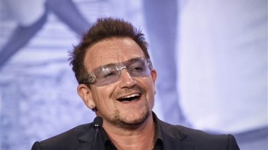 Bono, the Irish rock star and activist, speaks at the Symposium on Global Agriculture and Food Security following an appearance by President Barack Obama, Friday, May 18, 2012, at the Ronald Reagan Building in Washington. (AP Photo/J. Scott Applewhite)