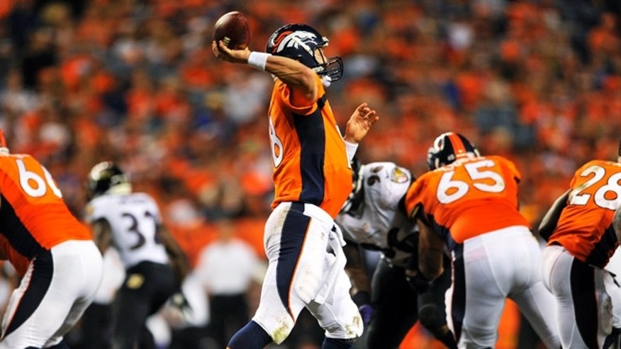 Denver Broncos quarterback Peyton Manning (18) throws his seventh touchdown of the game against the Baltimore Ravens during the second half of an NFL football game, Thursday, Sept. 5, 2013, in Denver. The Broncos won 49-27. Manning threw a record-tying seven touchdown passes â something no one had done in 44 years. (AP Photo/Jack Dempsey)