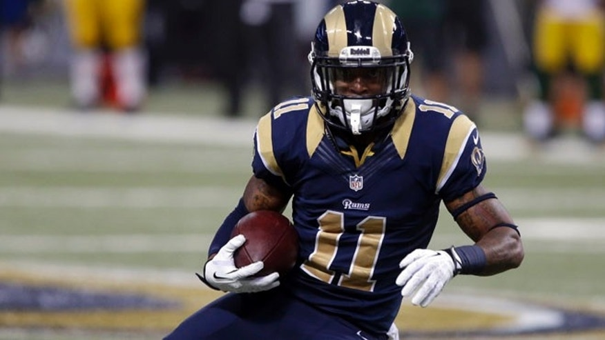 Aug. 17, 2013: In this file photo, St. Louis Rams wide receiver Tavon Austin runs with the ball during the second quarter of an NFL football game against the Green Bay Packers in St. Louis. The upcoming NFL season is driving tens of millions of people to make fantasy predictions about how America's most popular sport will play out.