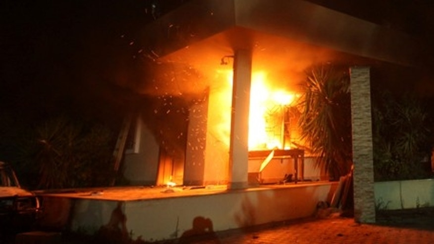 The U.S. Consulate in Benghazi is seen in flames during a protest by an armed group said to have been protesting a film being produced in the United States September 11, 2012. An American staff member of the U.S. consulate in the eastern Libyan city of Benghazi has died following fierce clashes at the compound, Libyan security sources said on Wednesday. Armed gunmen attacked the compound on Tuesday evening, clashing with Libyan security forces before the latter withdrew as they came under heavy fire. REUTERS/Esam Al-Fetori (LIBYA - Tags: POLITICS CIVIL UNREST) - RTR37UW6